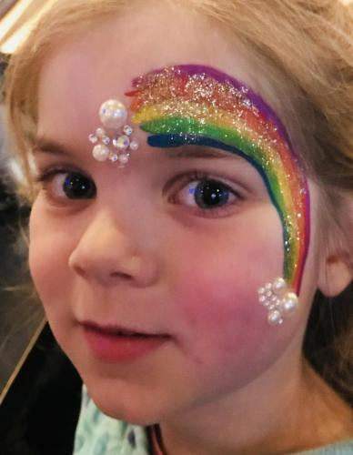 Rainbow face painting with glitter Chicago