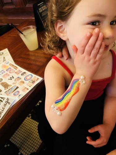 Rainbow arm painting with glitter