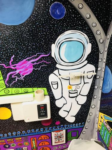 Sapcesuit with spaceship mural