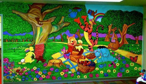 Winnie the pooh wall mural at a health club