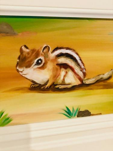 Chipmunk painting part of the sunflowers and castle wall mural