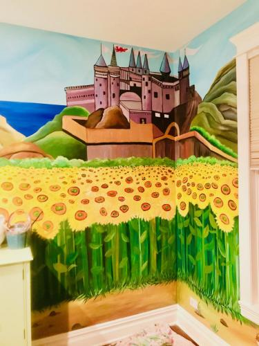 Sunflowers and castle wall mural