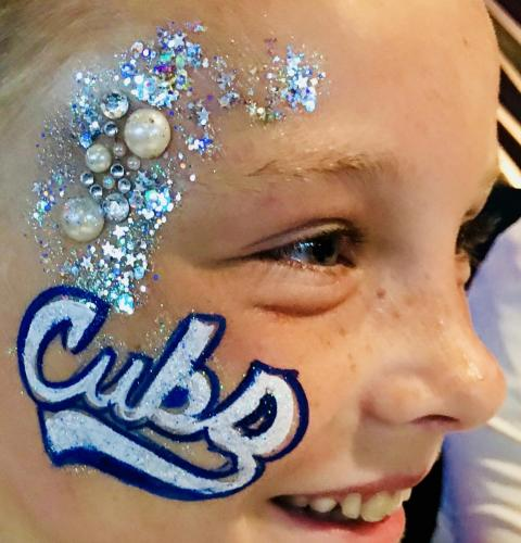 Chicago Cubs face painting with gems and glitter