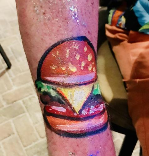 Cheese burger in paradise. Arm painting.