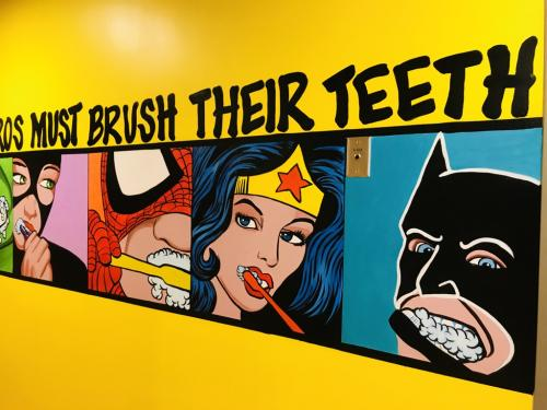 Little Teeth, big smiles. Even super hero's must brush their teeth wall mural