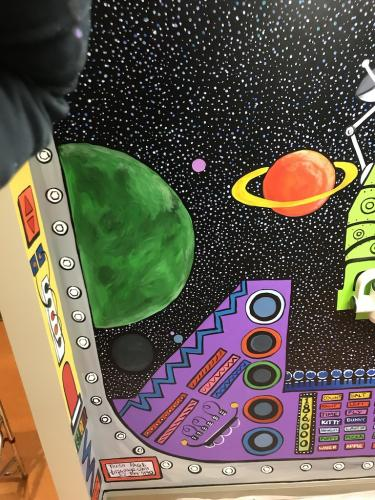 Little Teeth, big smiles x-ray room planets and spaceship wall mural